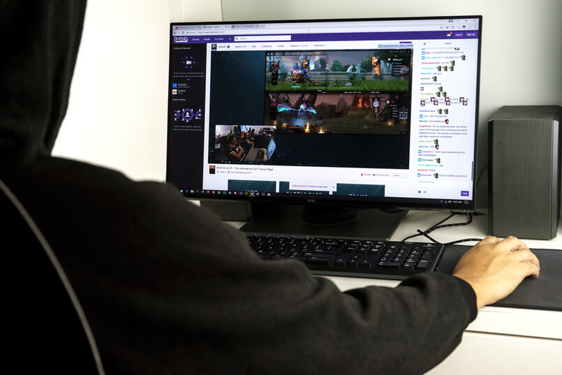 KUALA LUMPUR MALAYSIA AUG 4TH 2017 Unidentified man watching Dota 2 match on Twitch tv Twitch is a live streaming video platform owned by Twitch Interactive a subsidiary of Amazon com